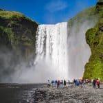 Rejser til Island | Vandfaldet Skógafoss kan man ikke undgå at se på kør-selv ferie i Island. North Travel.